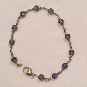 Purple crystal and silver beaded bracelet